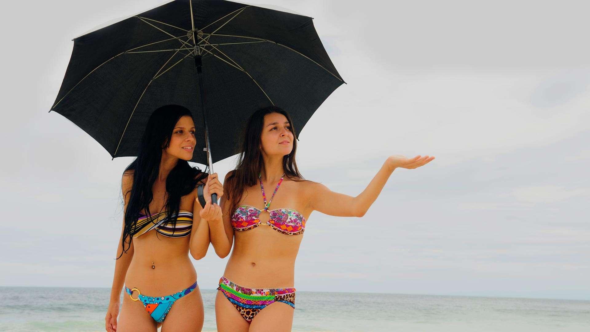 Two Women With Umbrella At Puerto Vallarta Beach