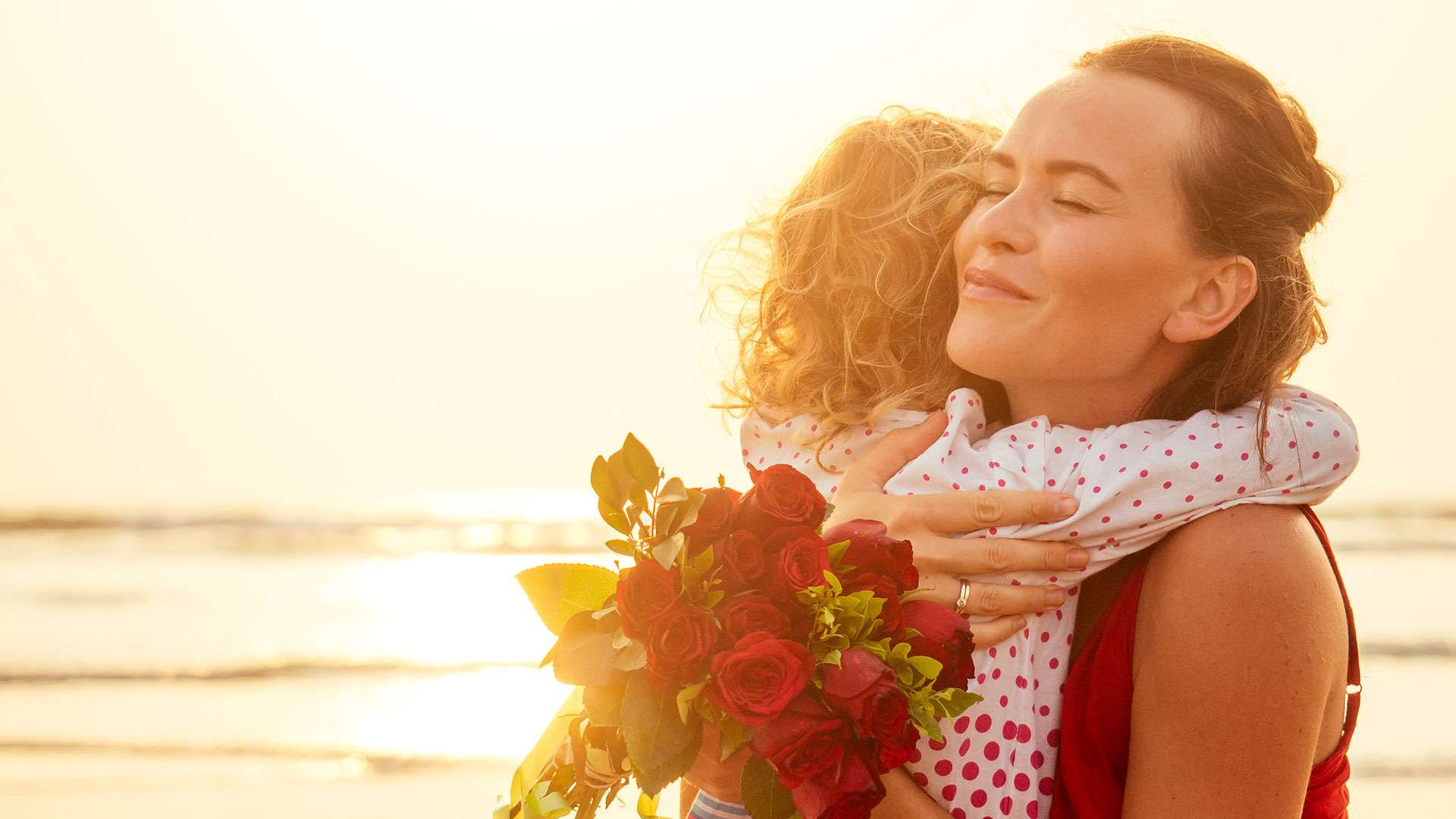 Mother And Daughter Celebrating Mothers Day On The Beach