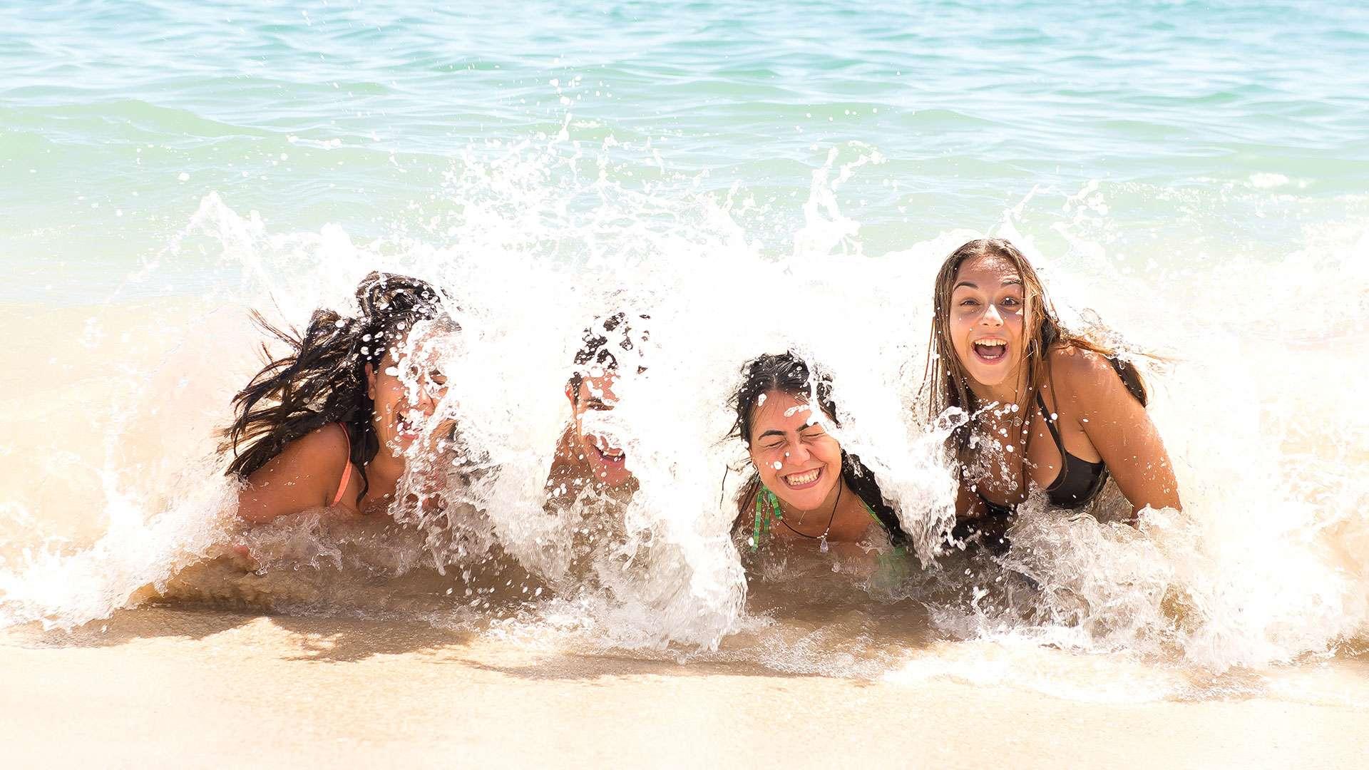 Friends Having Fun On The Beach